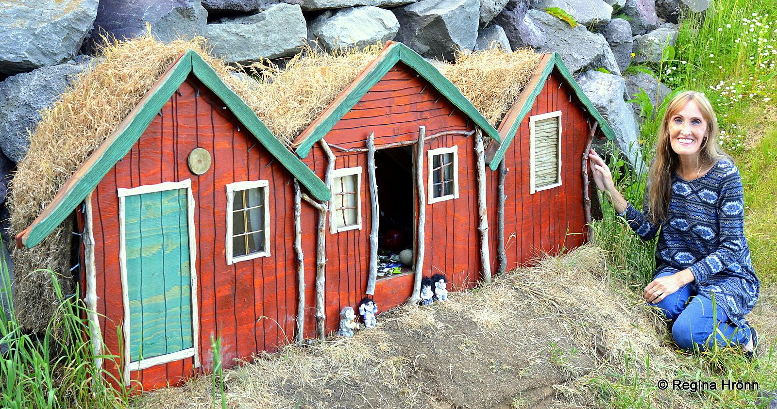 Regína by a replica of the elf house in Húsavík from the film Eurovision - the Fire Saga